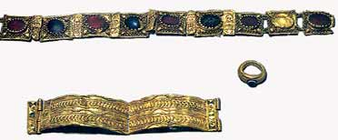 The treasure of Rhayader;  one gold ring set with onyx and engraved on the setting an ant, a portion of a gold necklet of nine pieces (eight links set with stones and one stone with the link missing), one piece of gold scroll, a small piece of embossed gold (both forming part of the necklet) and a gold armlet in four pieces.